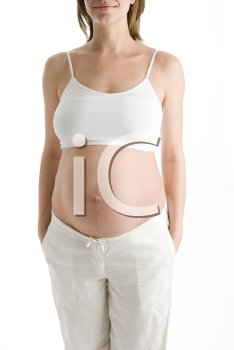 Royalty Free Photo of a Pregnant Woman With Her Stomach Exposed