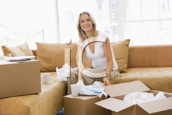 Royalty Free Photo of a Woman Unpacking