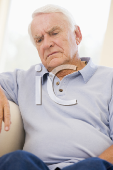 Royalty Free Photo of an Older Man Looking Unwell