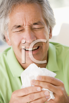Royalty Free Photo of a Man Blowing His Nose