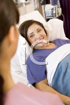 Royalty Free Photo of a Nurse Talking to a Patient