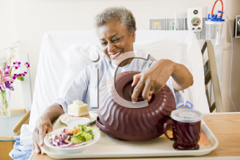 Royalty Free Photo of a Woman in the Hospital With Food