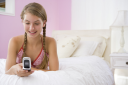 Royalty Free Photo of a Teenage Girl With a Cellphone