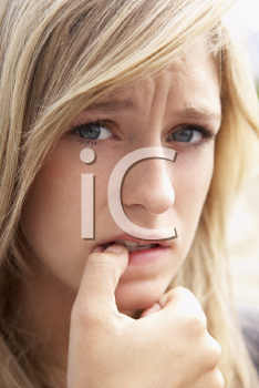 Royalty Free Photo of a Girl Biting Her Nails