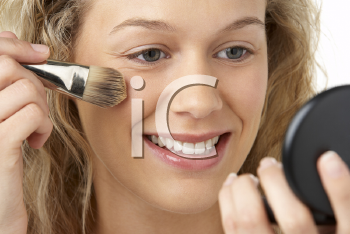 Royalty Free Photo of a Woman Applying Makeup