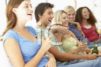 Royalty Free Photo of Boys and Girls Watching TV