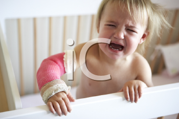 Royalty Free Photo of a Baby Girl With a Broken Arm