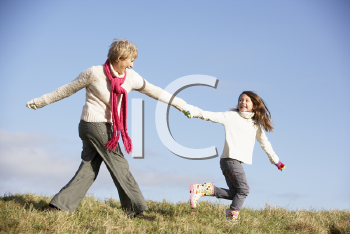 Royalty Free Photo of a Woman and Her Granddaughter Running Outside