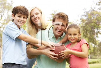 Royalty Free Photo of a Family With a Football