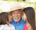 Royalty Free Photo of a Grandfather With His Grandchildren