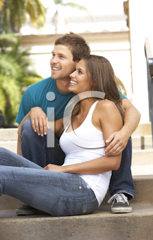Royalty Free Photo of a Couple Sitting on Stairs