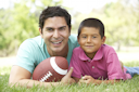 Royalty Free Photo of a Father and Son With a Football