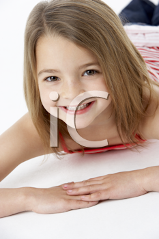 Young Girl Lying On Stomach In Studio