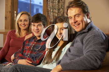 Portrait Of Family Relaxing On Sofa Together