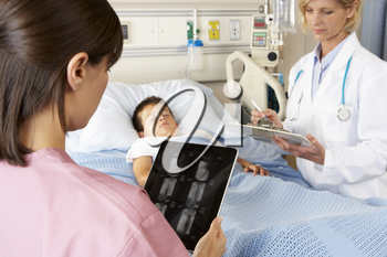 Nurse Using Digital Notepad Whilst Visiting Child Patient