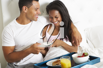 Man Bringing Woman Breakfast In Bed On Celebration Day