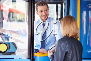Woman Boarding Bus And Using Pass