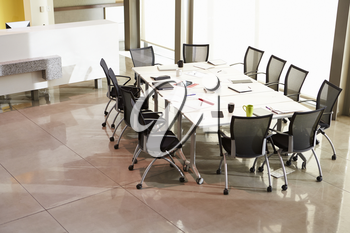 Chairs Arranged Around Empty Boardroom Table