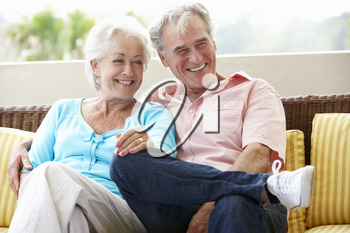 Senior Couple Sitting On Outdoor Seat Together