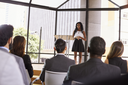 Young black businesswoman presenting seminar to an audience