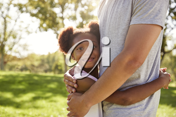 Close Up Of Father Hugging Daughter In Park
