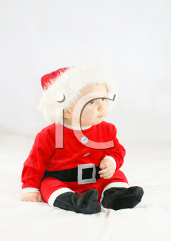 Cute baby boy in a santas outfit