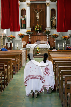 Royalty Free Photo of Worshippers on Their Knee at a Catholic Cathedral in Mexico