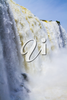 Water splashes and fog over Iguazu Falls on the border of Brazil, Argentina and Paraguay. Concept of active and extreme tourism