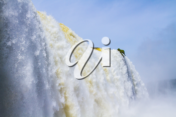 Waterfalls on the border of the Argentine and Brazilian national parks Iguazu. Concept of active and extreme tourism