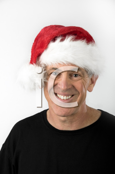 Royalty Free Photo of a Smiling Man in a Santa Hat