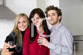 Royalty Free Photo of a Man and Women Drinking Wine