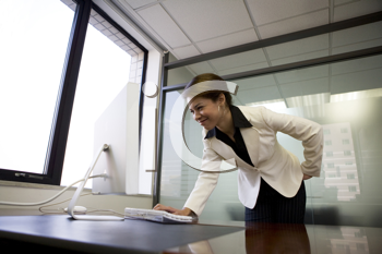 Royalty Free Photo of a Business Woman Leaning Over a Keyboard
