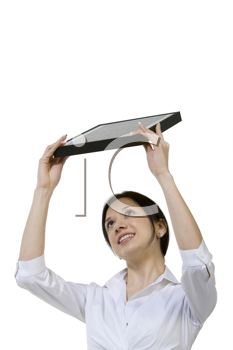Royalty Free Photo of a Woman Holding a Laptop Over Her Head