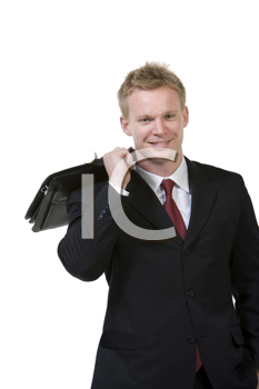 Royalty Free Photo of a Young Businessman With a Briefcase on His Shoulder
