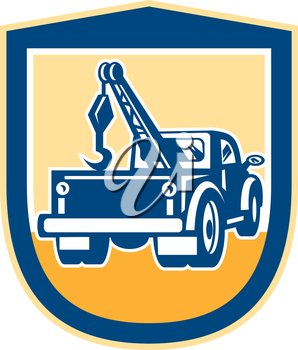 Illustration of a tow wrecker truck lorry viewed from rear set inside shield crest done in retro style on isolated background.