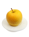 Royalty Free Photo of a Yellow Apple on a Plate