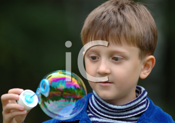 Royalty Free Photo of a Child With a Bubble