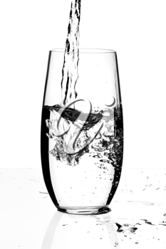 Glass with a water, isolated on a white background.