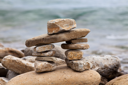 Royalty Free Photo of an Inukshuk on a Lake Huron Shore