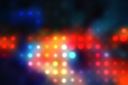Decorative christmas background - defocused reflection of lights.