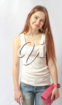 Portrait of a pretty, smiling blonde in jeans on white. 20-24 years old young women in studio front view
