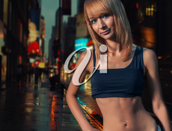Torso shot of a nude belly sporty women  in the gstreet. Colorized image