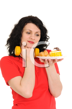 Royalty Free Photo of a Woman Exercising and Looking at Food