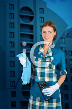 Royalty Free Photo of a Cleaner in Front of an Apartment Building