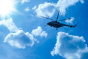Royalty Free Photo of a Helicopter Flying in the Sky