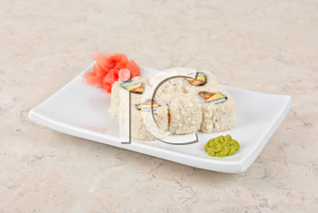 Sushi rolls of rice, omelette, eel and sesame