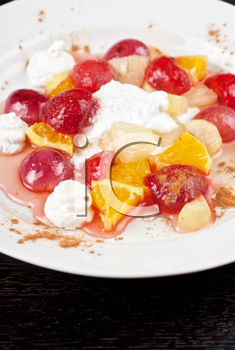fruit salad of pineapple, grape, orange and strawberry with whipped cream