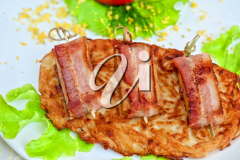 roast of veal meat with bacon with potatoes