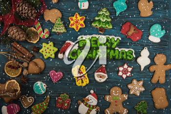 Gingerbreads for new years and christmas on wooden background, xmas theme