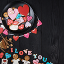 Gingerbreads for Valentines Day on dark concrete background